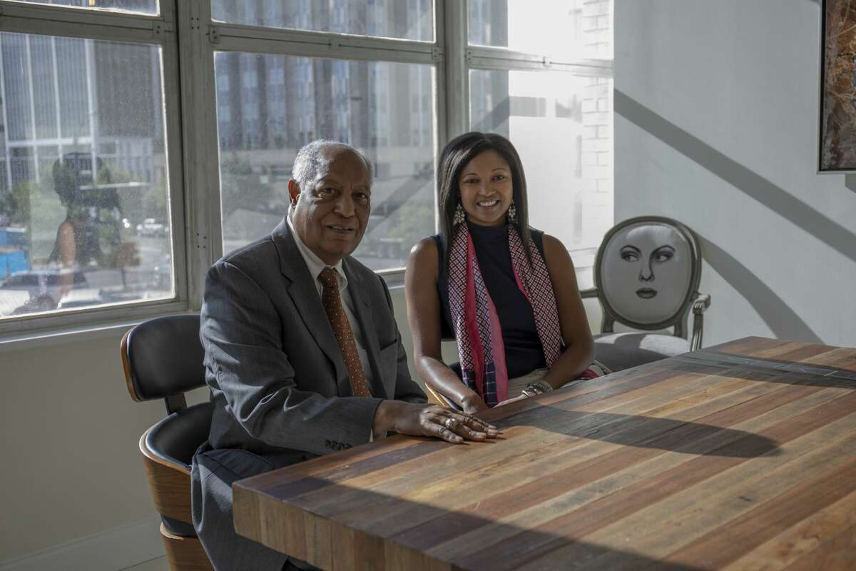 Father Larry Lawrence and daughter Jessica Rule pose for a photo June 5, 2019 at Rule's advertising firm SHK. Jacy Lewis/Reporter-Telegram