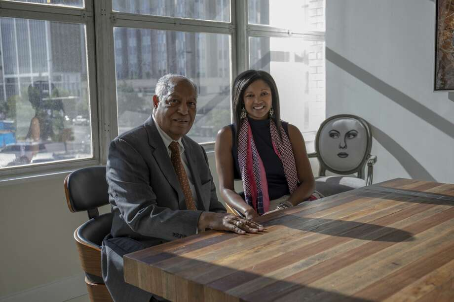 Father Larry Lawrence and daughter Jessica Rule pose for a photo June 5, 2019 at Rule's advertising firm SHK.   Jacy Lewis/Reporter-Telegram Photo: Jacy Lewis/191 News