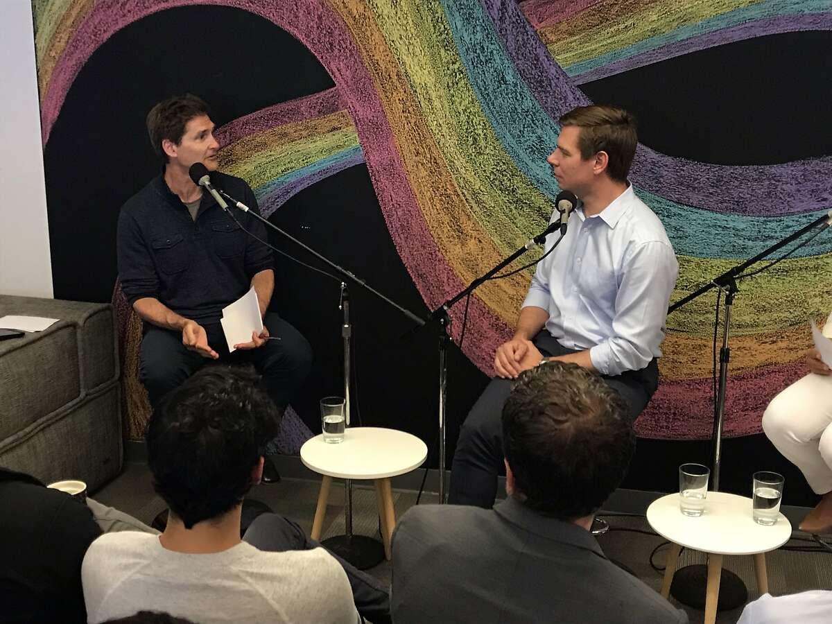 Rep. Eric Swalwell (right) answers a question from Carl Guardino of the Silicon Valley Leadership Group at a San Francisco town Hal