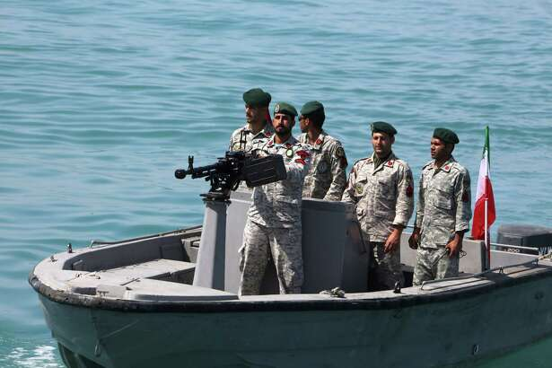 "In this file photo taken on April 30, 2019, Iranian soldiers take part in an observance of ""National Persian Gulf Day"" in the Strait of Hormuz."