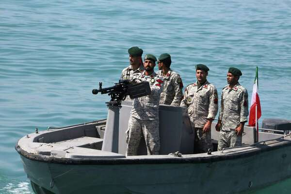 """In this file photo taken on April 30, 2019, Iranian soldiers take part in an observance of """"National Persian Gulf Day"""" in the Strait of Hormuz."""