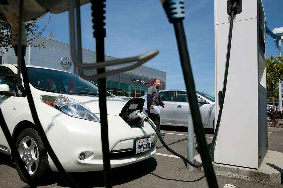 An older model Nissan LEAF is charged at the Jim Bone Nissan dealership in Santa Rosa, California, Thursday, May 3, 2018. Nissan plans to sell a new Leaf which will emit a resonant hum to warn pedestrians of the approach of the quiet electric car. Photo: RAMIN RAHIMIAN / Special To The Chronicle
