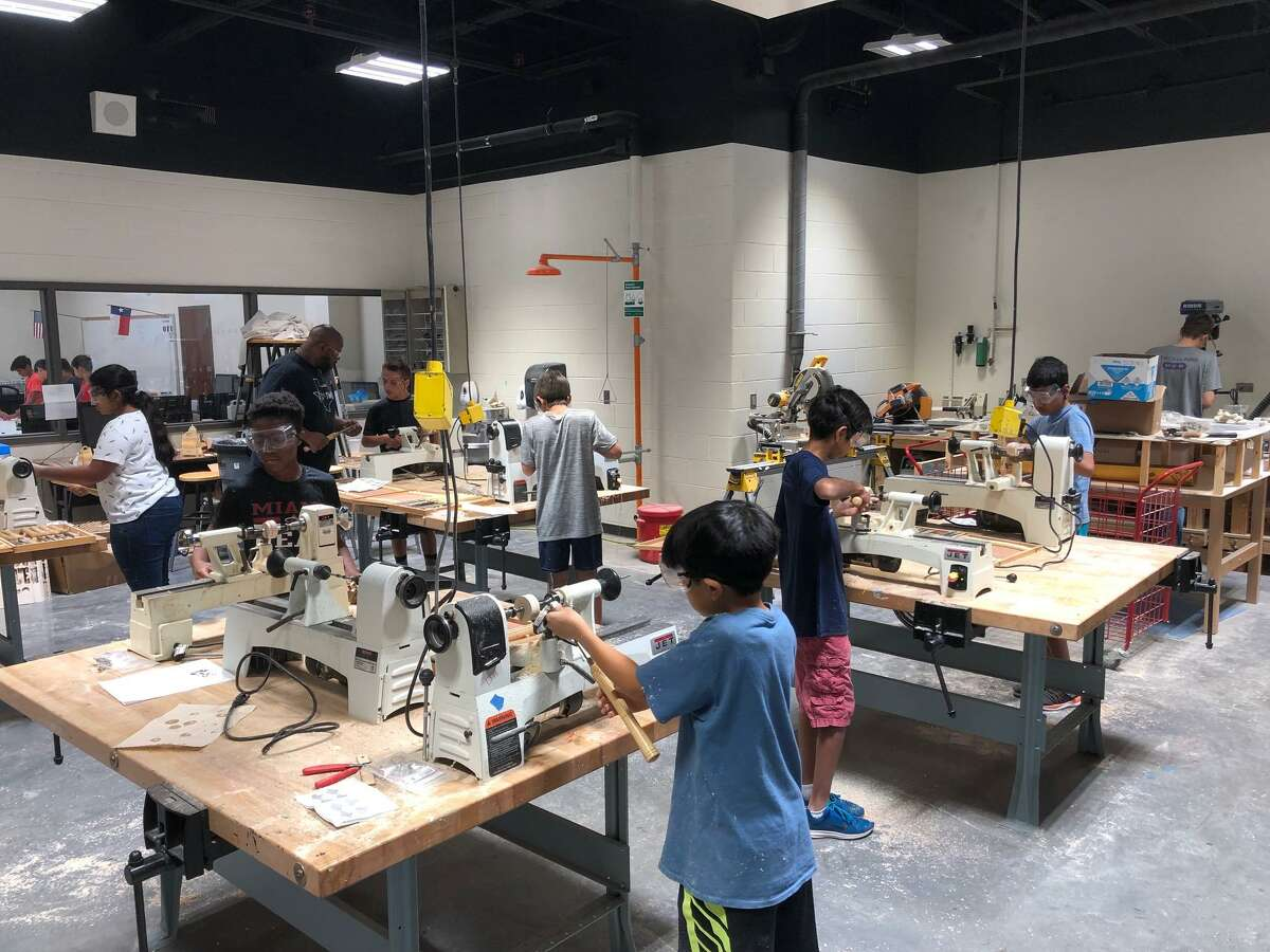 Students work on lathes during Katy Independent School District's fifth annual STEM Summer Camp.