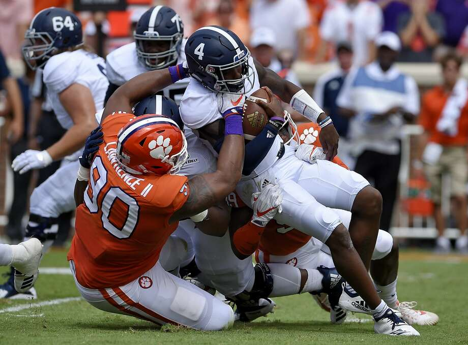 FILE - In this Sept. 15, 2018, file photo, Clemson's Dexter Lawrence brings down Georgia Southern quarterback Shai Werts during the first half of an NCAA college football game, in Clemson, S.C. Lawrence is a possible pick in the 2019 NFL Draft. (AP Photo/Richard Shiro, File) Photo: Richard Shiro, Associated Press