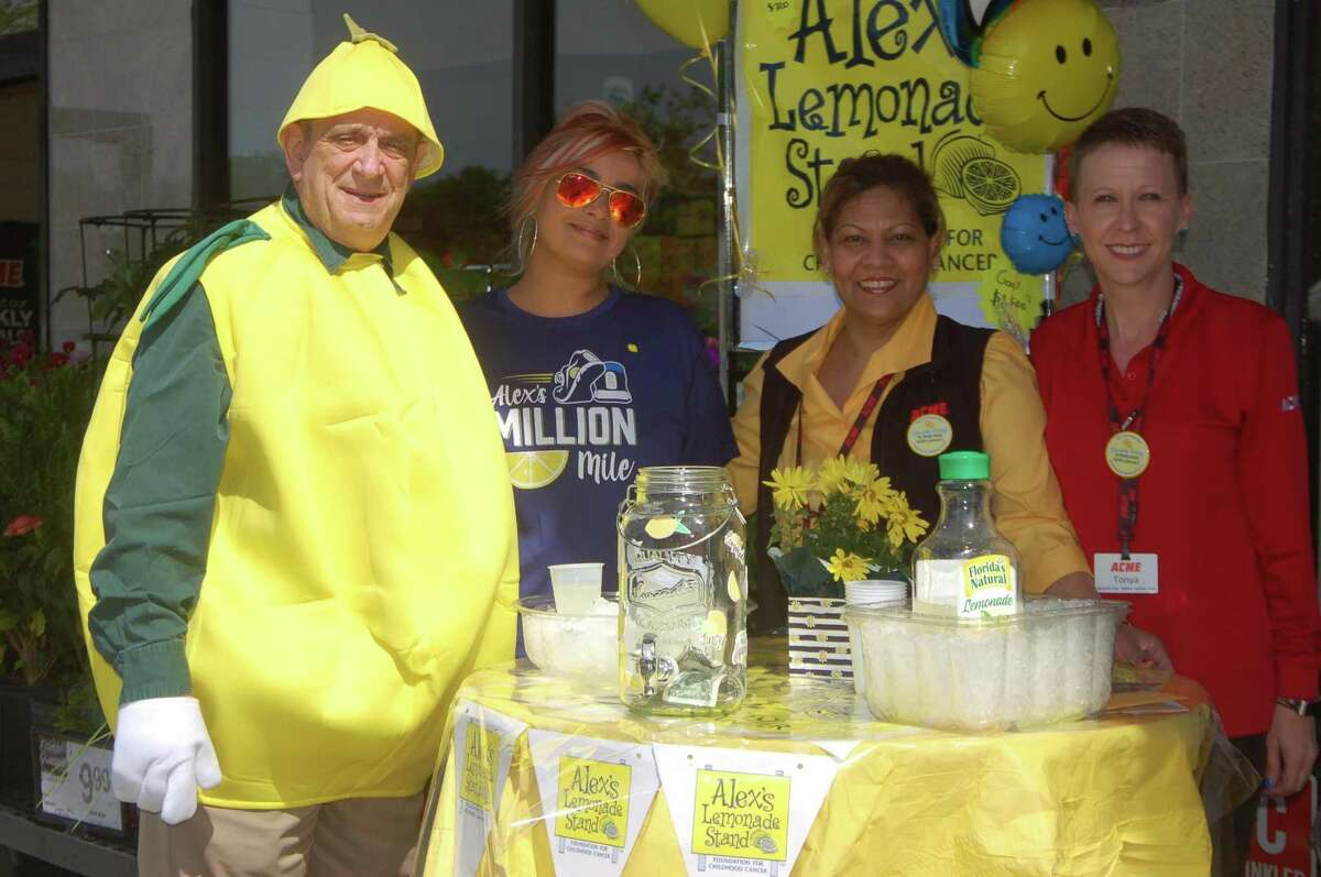 Town resident Sam Romeo, left, slipped into a lemon suit last week for a good cause. He is joined by his daughter Lindsey Romeo Weber; Ally Ali, Acme Supermarkets customer service manager; and Tonya Rodriguez, an Acme cashier, to boost Alex's Lemonade Stand. Romeo collects donations outside the store for the charity, which helps in the fight against pediatric cancer.