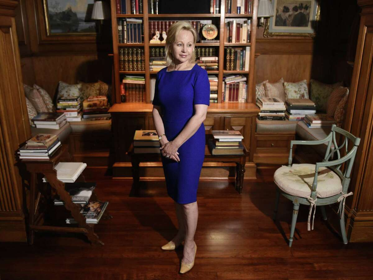 """Soap opera star Deborah Goodrich Royce, author of """"Finding Mrs. Ford,"""" poses at her home in the Riverside section of Greenwich, Conn. Monday, June 10, 2019. In Royce's debut novel, a literary thriller, the main character's """"cocoon of privilege is threatened when an Iraqi man from her distant past boards a plane in Baghdad to come find her."""""""