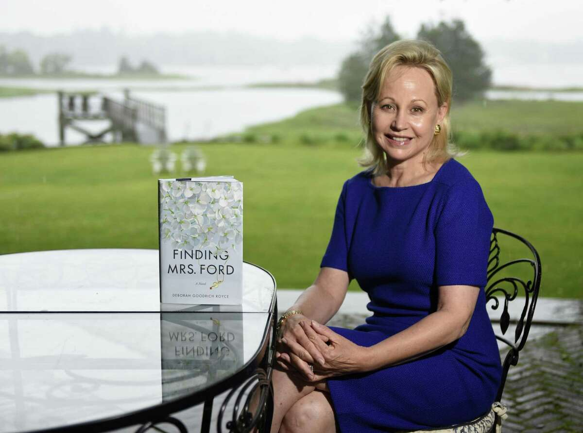 """Soap opera star Deborah Goodrich Royce poses with her new book """"Finding Mrs. Ford"""" at her home in the Riverside section of Greenwich, Conn. Monday, June 10, 2019. In Royce's debut novel, a literary thriller, the main character's """"cocoon of privilege is threatened when an Iraqi man from her distant past boards a plane in Baghdad to come find her."""""""
