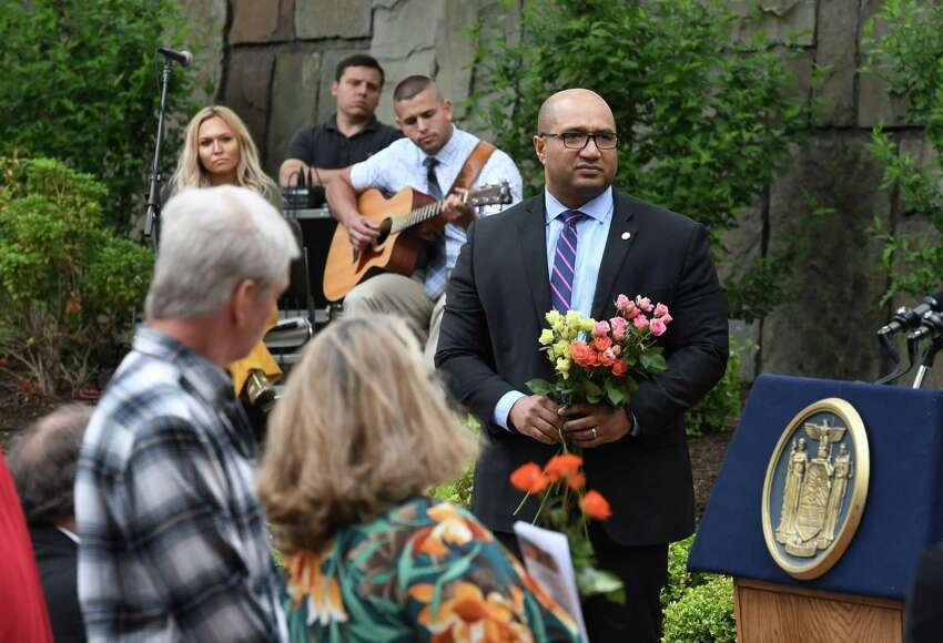 Albany County District Attorney David Soares stands near the podium to support family and friends of crime victims who came to pay tribute to fallen loved ones during the annual New York State crime victims dedication ceremony on Friday, June 14, 2019, at the Empire State Plaza in Albany, N.Y. (Will Waldron/Times Union)