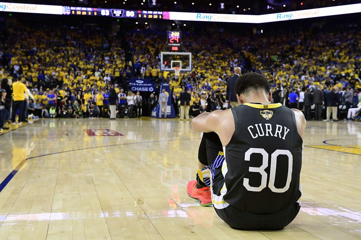 Golden State Warriors guard Stephen Curry reacts after teammate Klay Thompson was injured during the second half against the Toronto Raptors in Game 6 of basketball's NBA Finals, Thursday, June 13, 2019, in Oakland, Calif.