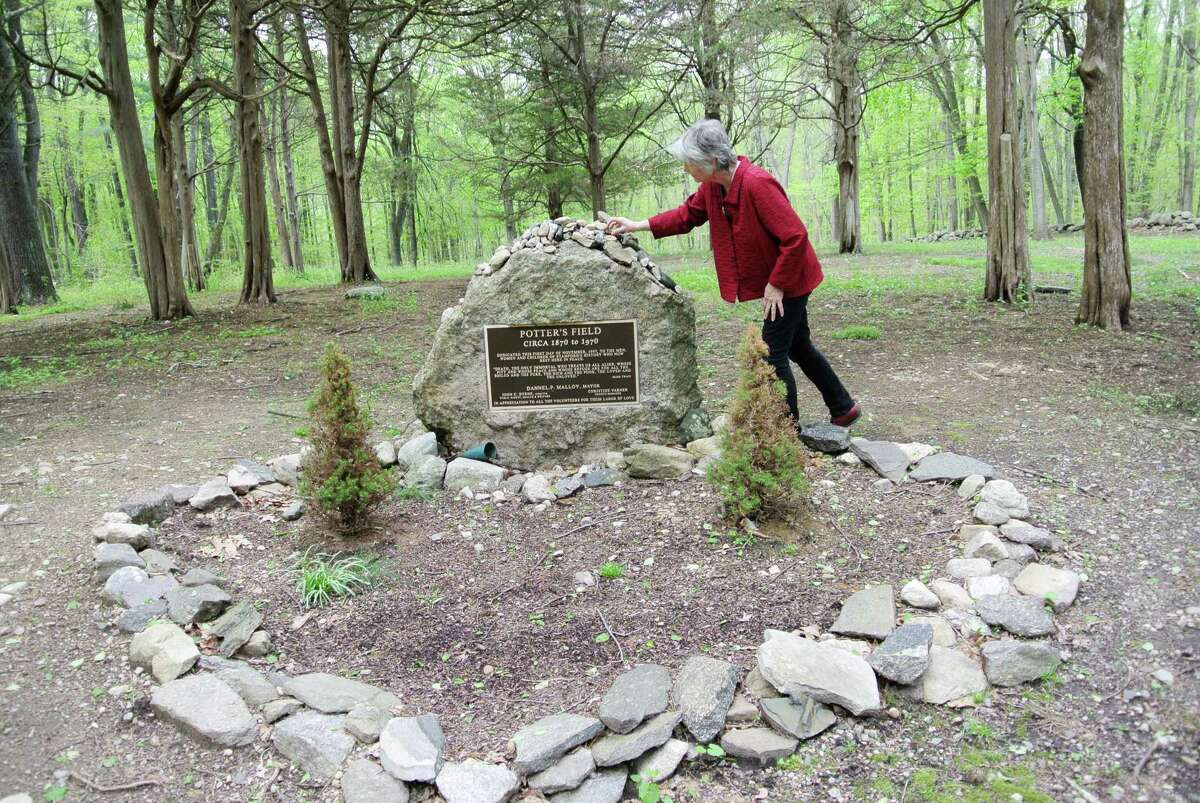 JoeAnn Hart visits the potter's field in North Stamford where her friend Margo Olson's body was found in 1976. Hart has written a book on the murder.