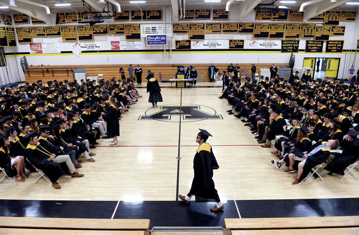 Graduates wait in the gymnasium for commencement exercises to begin at Amity Regional High School on June 14, 2019.