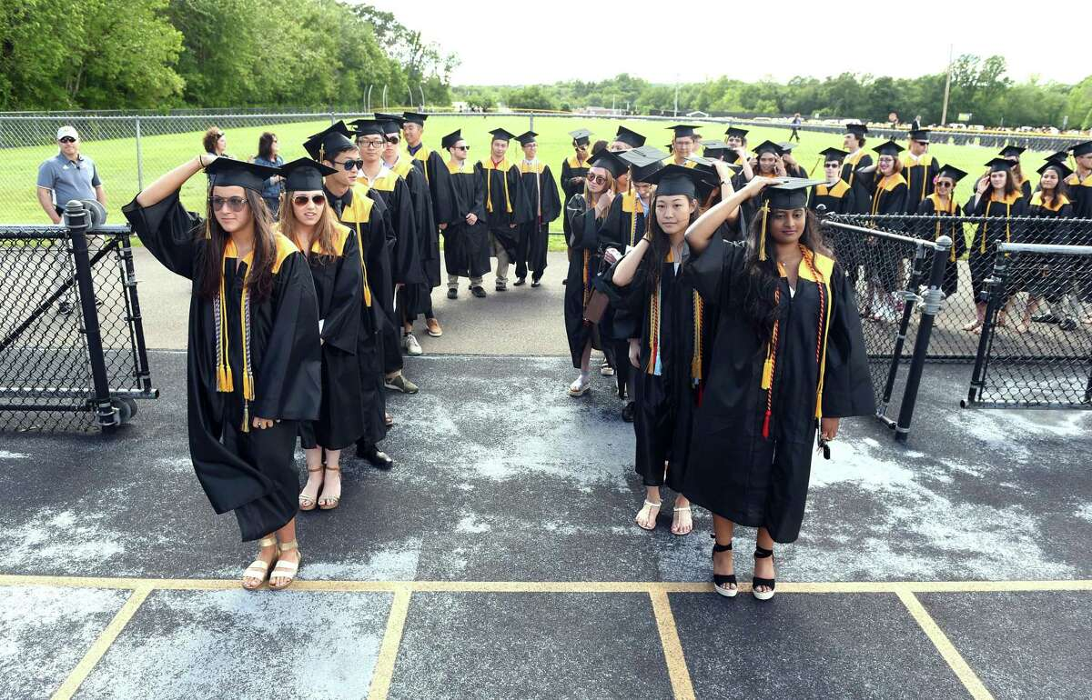 Graduates prepare to walk onto the football field for commencement exercises at Amity Regional High School on June 14, 2019.