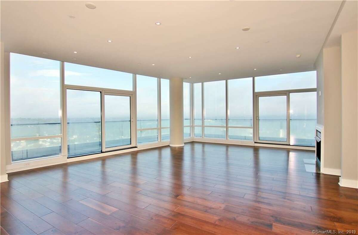 This duplex penthouse at the top of the Trump Parc Stamford condo tower has sold for $1.225 million.