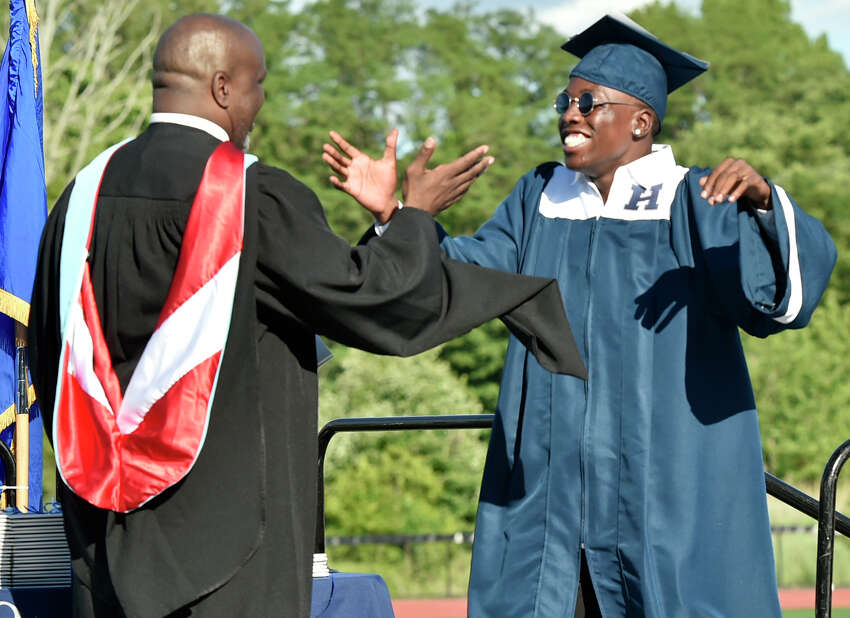New Haven, Connecticut - Friday, June 14, 2019: Zahyid Jackson gets a warm welcome from Principal Glen Worthy before getting his diploma during the Hillhouse H.S. 160th Commencement Exercises for the Class of 2019 Friday at Bowen Field in New Haven.