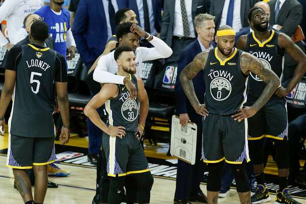 The Golden State Warriors wait for officials' ruling in the final seconds of game 6 of the NBA Finals between the Golden State Warriors and the Toronto Raptors at Oracle Arena on Thursday, June 13, 2019 in Oakland, Calif.