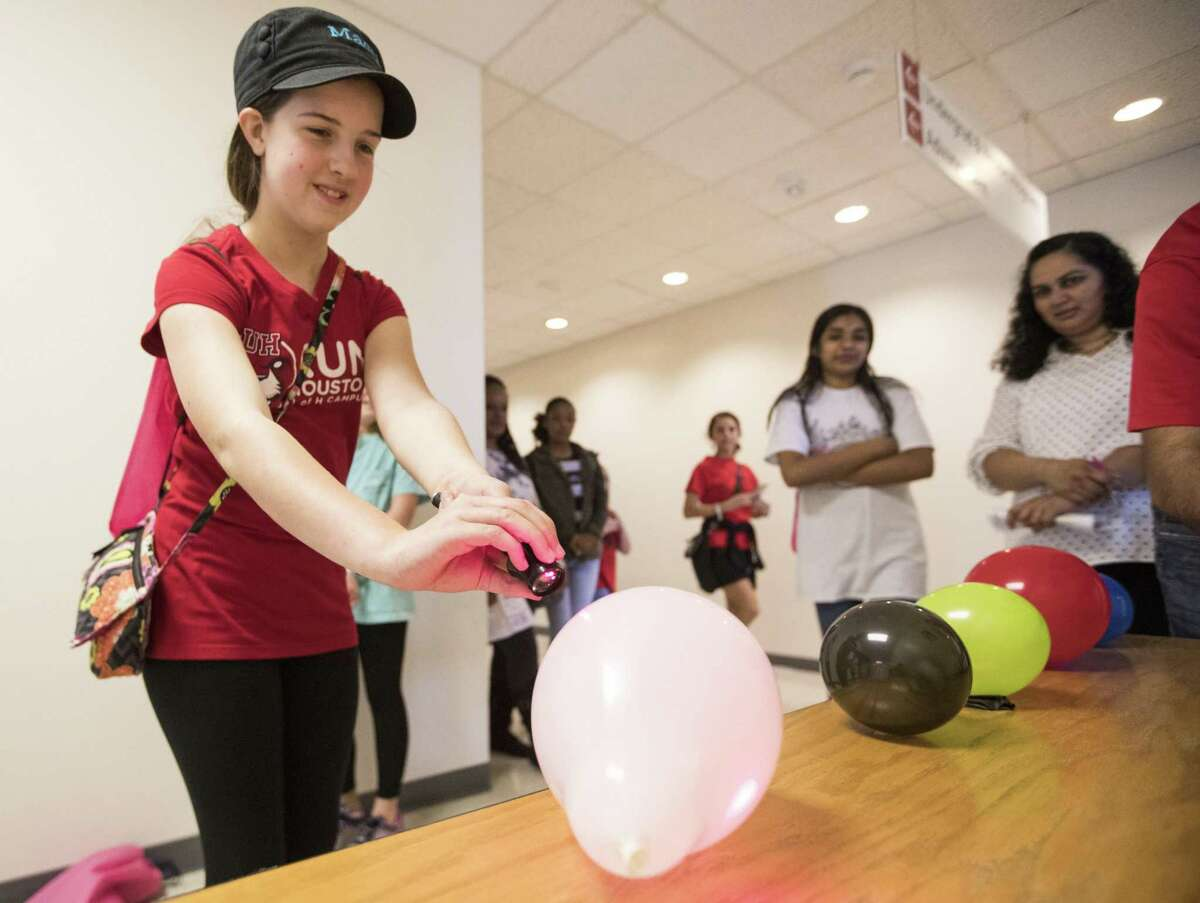 During the University of Houston's Chevron Girls Engineering the Future STEM Day on Saturday, March 30, 2019, Macy Kleihege does an experiment with light and a laser. Girls in the fourth- through eighth-grades participated in hands-on activities organized by faculty and student organizations from the university's Cullen College of Engineering, College of Natural Sciences and Mathematics and College of Technology.