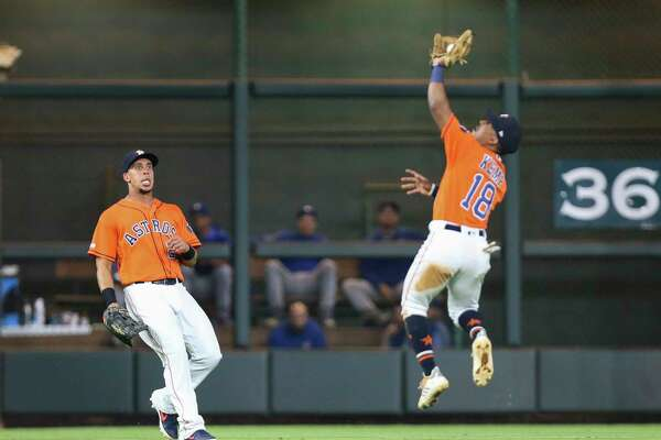 Houston Astros left fielder Michael Brantley (23) reacts to second baseman Tony Kemp (18) leaping to catch a fly ball during the top fifth inning of the MLB game against the Toronto Blue Jays at Minute Maid Park on Friday, June 14, 2019, in Houston.