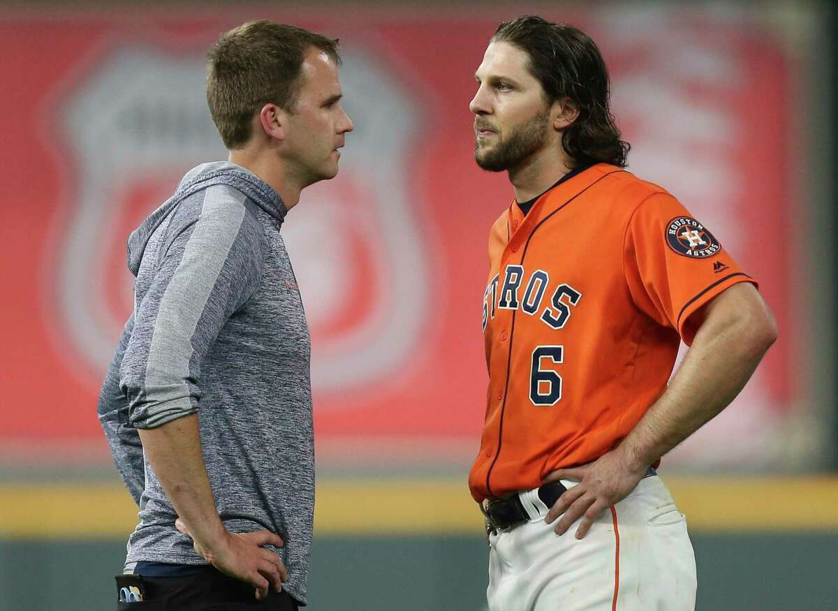 Houston Astros center fielder Jake Marisnick (6) talks to a trainer before the top sixth inning of the MLB game at Minute Maid Park on Friday, June 14, 2019, in Houston. He left the game after the talk. Marisnick slide and rolled on the ground while trying to catch a fly ball in top fifth inning.
