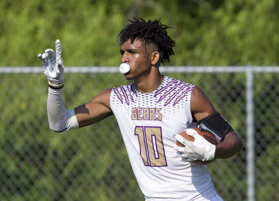 Montgomery wide receiver Keshon Hill (10) reacts after catching a touchdown pass from quarterback Brock Bolfing during a 7-on-7 football game at Porter High School, Friday, June 14, 2019, in Porter. Photo: Jason Fochtman, Houston Chronicle / Staff Photographer / Houston Chronicle
