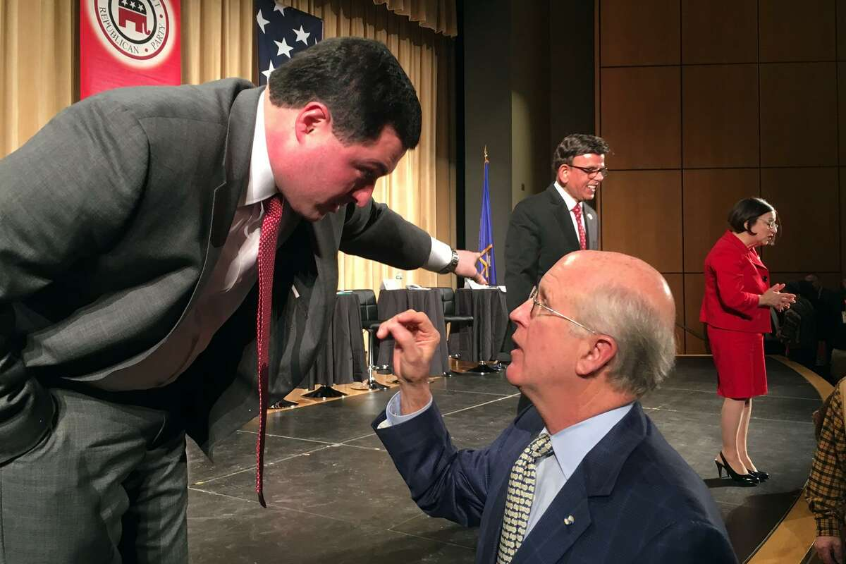 Candidates Tim Herbst and David Walker talk following the Connecticut GOP Gubernatorial Debate held in Hebron Jan. 10, 2018.