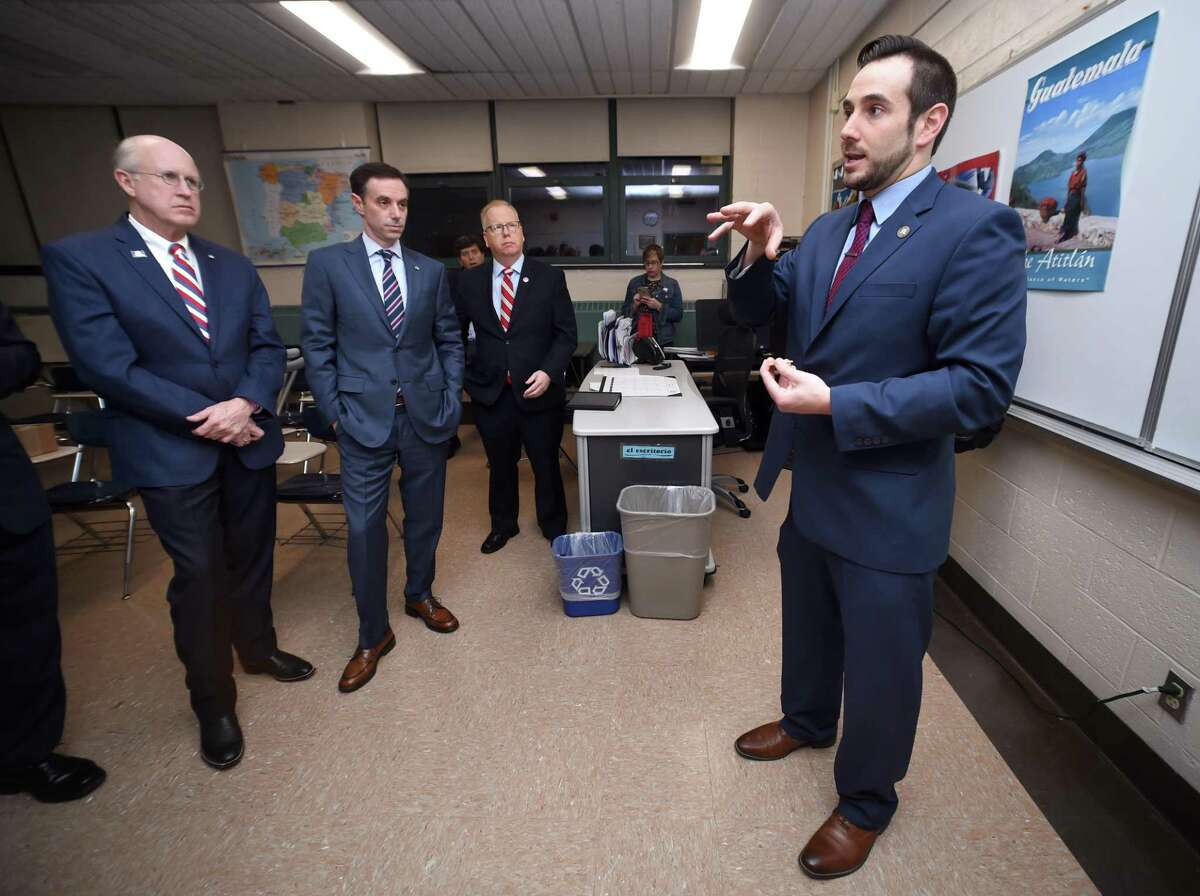 Left to right, Dave Walker, Mike Handler, Stamford CFO, and Danbury Mayor Mark Boughton listen to state GOP chairman J.R. Romano go over ground rules for the gubernatorial debate at Notre Dame High School in West Haven on Feb. 21, 2018.