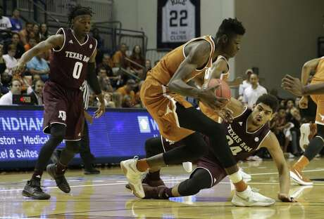 Texas Longhorns forward Mohamed Bamba (4) controls a loose ball defended by Texas A&M Aggies center Tyler Davis (34) in the first half during the exhibition basketball game between the Texas Longhorns and the Texas A&M Aggies to benefit the Rebuild Texas Relief Fund at Tudor Fieldhouse in Houston, TX on Wednesday, October 25, 2017.