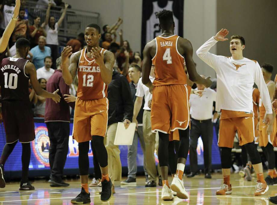 Texas Longhorns forward Mohamed Bamba (4) and guard Kerwin Roach II (12) celebrate after the exhibition basketball game between the Texas Longhorns and the Texas A&M Aggies to benefit the Rebuild Texas Relief Fund at Tudor Fieldhouse in Houston, TX on Wednesday, October 25, 2017. Photo: Tim Warner, Freelance / For The Chronicle / Houston Chronicle