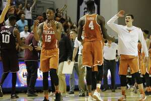 Texas Longhorns forward Mohamed Bamba (4) and guard Kerwin Roach II (12) celebrate after the exhibition basketball game between the Texas Longhorns and the Texas A&M Aggies to benefit the Rebuild Texas Relief Fund at Tudor Fieldhouse in Houston, TX on Wednesday, October 25, 2017.