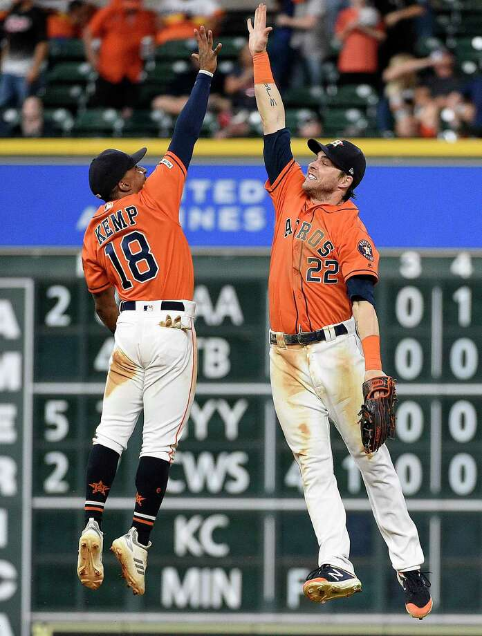 Houston Astros' Tony Kemp (18) and Josh Reddick celebrate their win over the Toronto Blue Jays in a baseball game, Friday, June 14, 2019, in Houston. (AP Photo/Eric Christian Smith) Photo: Eric Christian Smith, Associated Press / Copyright 2019 The Associated Press. All rights reserved.