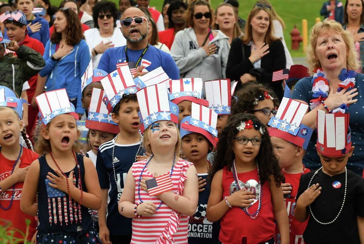 School 14 students recite the Pledge of Allegiance during their annual Red, White and Blue Day celebration to commemorate Flag Day on Friday morning, June 14, 2019, in Troy, N.Y. Flag Day honors the adoption of the U.S. flag on June 14, 1777. (Will Waldron/Times Union)