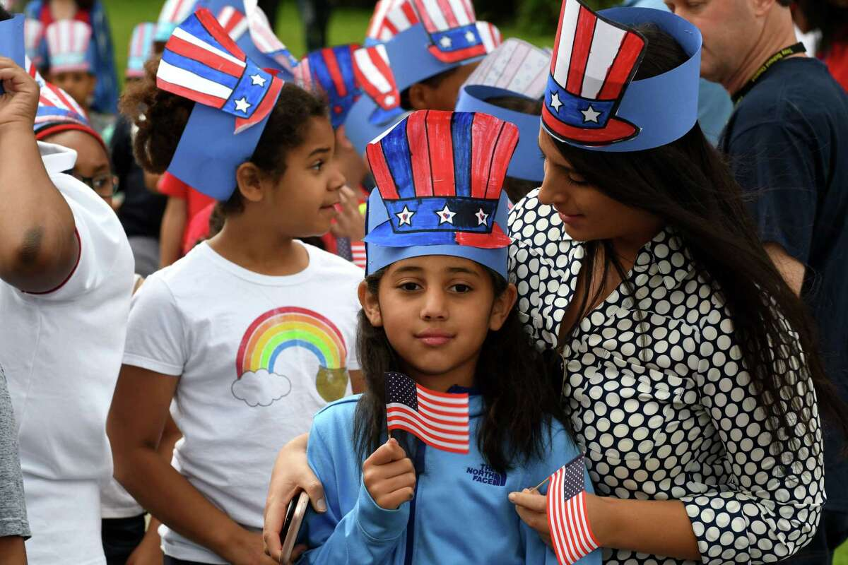 School 14 third-grader Annalise Alarcon waves the Stars and Stripes as she participates in the school's annual Red, White and Blue Day celebration to commemorate Flag Day on Friday morning, June 14, 2019, in Troy, N.Y. Flag Day honors the adoption of the U.S. flag on June 14, 1777. (Will Waldron/Times Union)