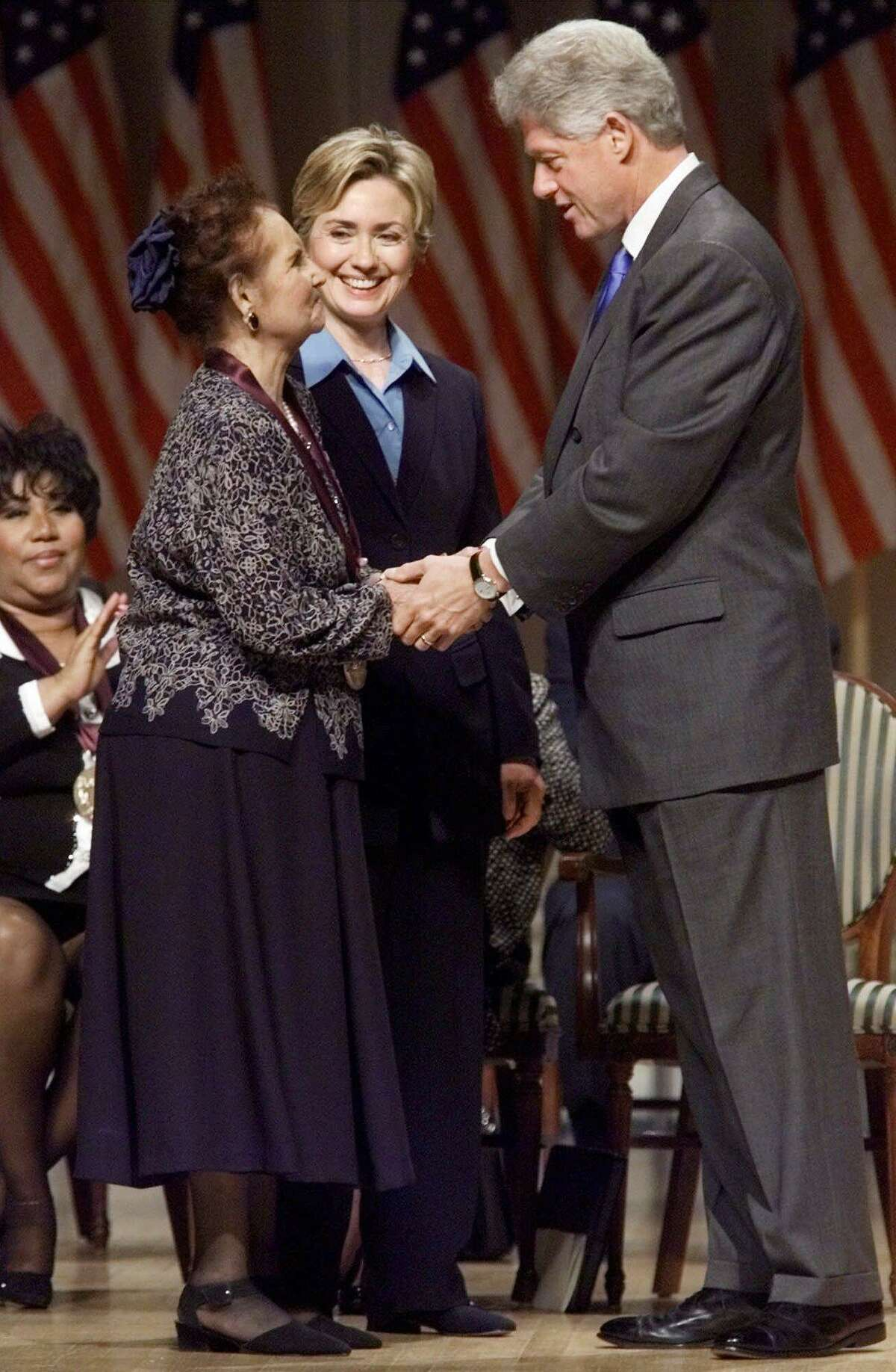 President Clinton talks with Mexican singer Lydia Mendoza after presenting her with a National Medal of Arts, Wednesday Sept. 29, 1999 in Washington. First lady Hillary Rodham Clinton is at center. (AP Photo/Khue Bui)