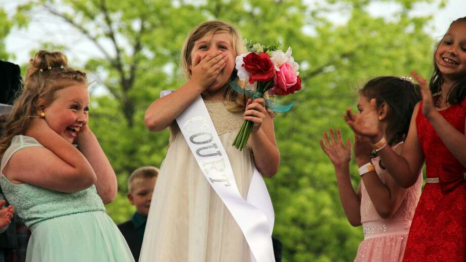 Brailee Kuhl of Sebewaing celebrates after winning the title of runner-up sugar princess at the 55th Sebewaing Sugar Festival. This was night two of the festival and featured crownings of the sugar queen, prince, and princess. Photo: Andrew Mullin/Huron Daily Tribune