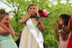 Brailee Cuhl of Sebewaing celebrates after winning the title of runner-up sugar princess at the 55th Sebewaing Sugar Festival. This was night two of the festival and featured crownings of the sugar queen, prince, and princess.