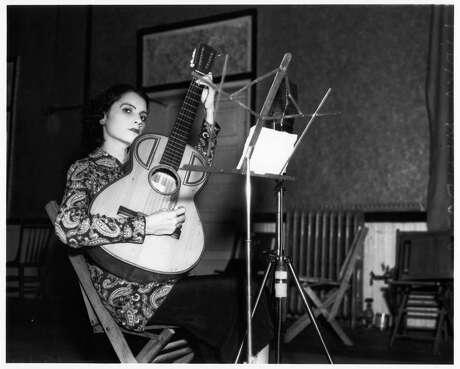 Lydia Mendoza, 20, records for RCA-Victor in San Antonio on Oct. 21, 1936. Mendoza rarely smiled, even for publicity photos.