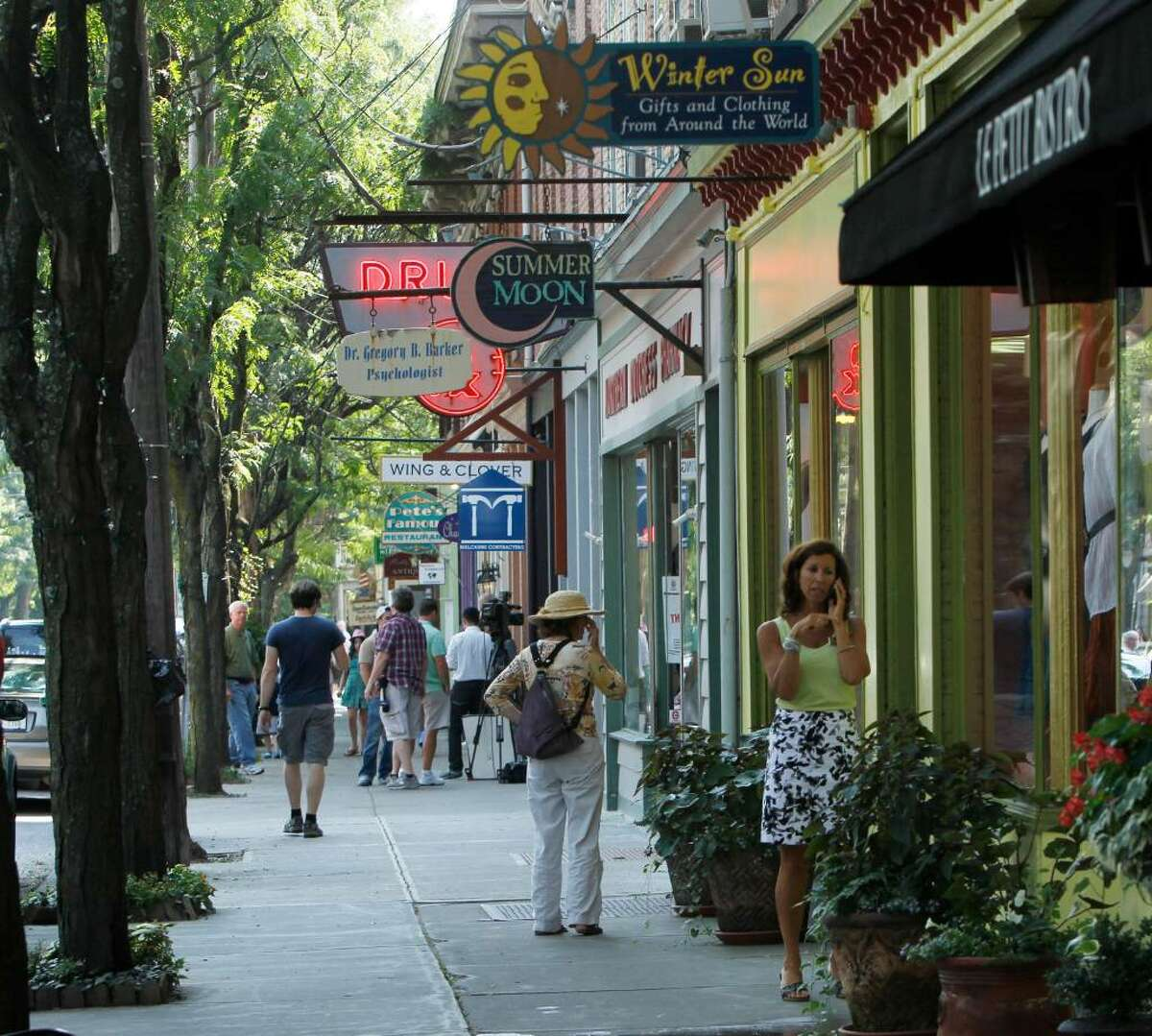 Tourists and locals walk along East Market Street in Rhinebeck. Chelsea Clinton is expected to marry Marc Mezvinsky in the village on Saturday. (Mike Groll / Associated Press)