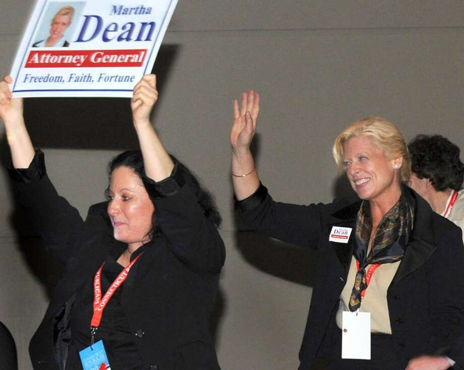 Martha Dean, center, with her husband and campaign manager, Malcolm McGough, acknowledges the crowd after winning her party's nomination for Attorney General Saturday at the Republican State Convention. Photo: Carol Kaliff / The News-Times