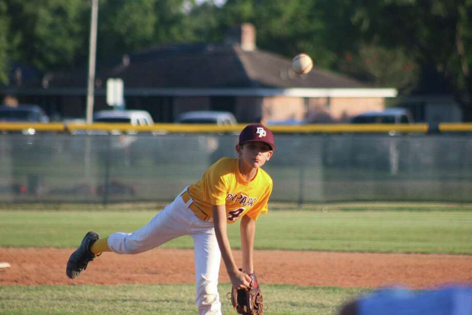 Deer Park Bronco all-star relief pitcher Mason Smith works the final inning of Friday night's win over the Friendswood 11s. Smith got the team out of a jam in the third then mopped up in the fourth and fifth. Photo: Robert Avery