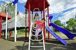 Children including Valeria and Alfonso Ochoa, 7 and 4, play at the Sandy Ground, Where Angels Play project playground dedicated to Allsion Wyatt the Friday, June 14, 2019, at Osyter Shell Park in Norwalk, Conn. As a part of the Walk Bridge Program, the state DOT will be doing remediation along the river at Oyster Shell Park. However, in order to do so, the playground will need to be closed for about 2 months in the spring of 2021. Please get a few photos of the playground and overlooking the river from the park.