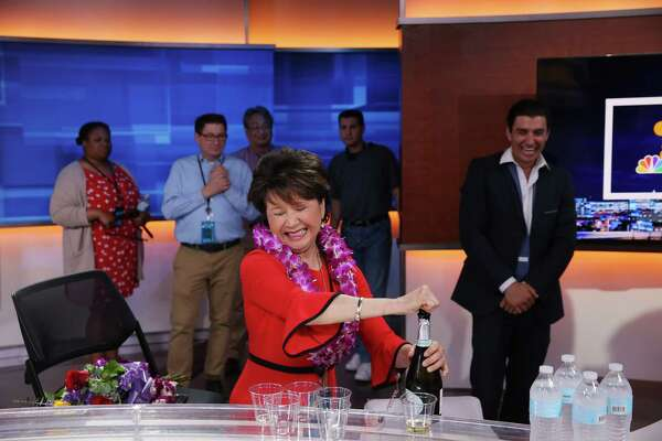 Lori Matsukawa opens a bottle of champagne and celebrates with coworkers after anchoring the 11pm show, her final live news broadcast before retiring after a 36 years in the business, Friday, June 14, 2019.