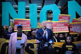 CHICAGO, ILLINOIS - MAY 23: Democratic presidential candidate and Washington governor Jay Inslee joins demonstrators at a rally in front of McDonald's corporate headquarters to demand $15-per-hour wages for fast food workers on May 23, 2019 in Chicago, Illinois. Inslee is one of more than 20 candidates who are seeking the 2020 Democratic nomination for president. (Photo by Scott Olson/Getty Images)