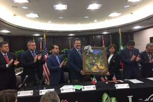 City officials from both Laredo and Nuevo León gather at City Hall Council Chambers on Friday and exchange gifts.