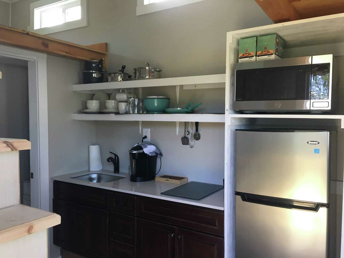 The tiny home is located in Malta Gardens, and was constructed by students at Ballston Spa High School and over a dozen organizations that volunteered or donated material. The home features a loft bed space, a kitchen area and bathroom.