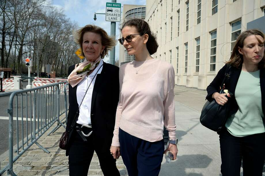 Clare Bronfman (center), an heiress to the Seagram liquor fortune and a NXIVM member, leaves the Brooklyn courthouse on April 8. She was one of Keith Raniere's loyal followers. Photo: Jefferson Siegel / New York Times