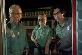 """This image released by Focus Features shows Bill Murray, from left, Chloe Sevigny and Adam Driver in a scene from """"The Dead Don't Die."""" (Abbot Genser/Focus Features via AP)"""