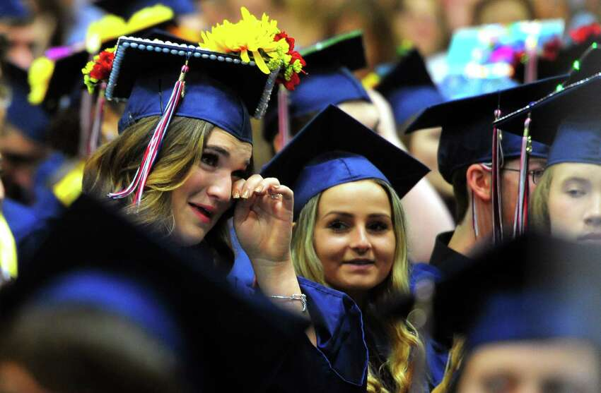 Graduate Kate Nieves wipes away a tear during New Fairfield's High School's 44th Commencement Exercises at at the O'Neill Center at Western Connecticut State University in Danbury, Conn., on Saturday June 15, 2019.