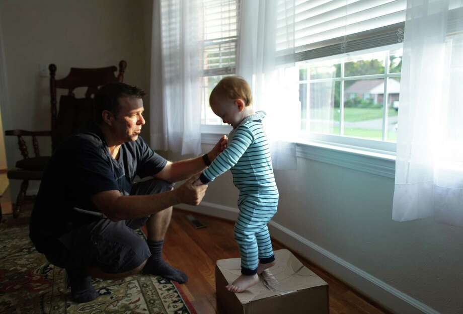 Pat Gallagher plays with his son Patrick, 22 months, at their home in Virginia Beach on June 11, 2019. Photo: Photo For The Washington Post By Vicki Cronis-Nohe / Vicki Cronis-Nohe