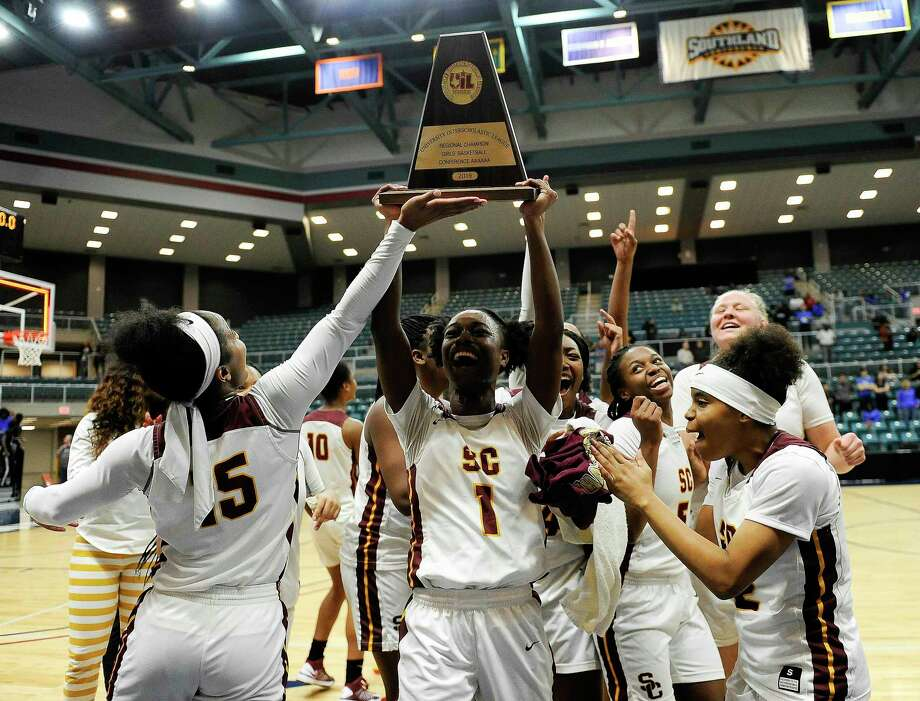 Summer Creek's Adaora Nwokeji (1) hoists the champion's trophy after the team's triple overtime win over Westside in a 6A regional championship basketball game, Saturday, Feb. 23, 2019, in Katy, TX. Summer Creek won the game in triple overtime, 72-63. Photo: Eric Christian Smith, Contributor / Contributor