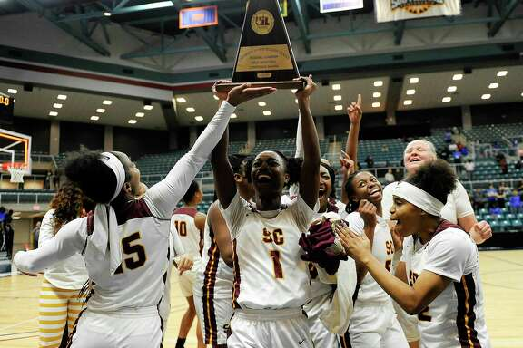 Summer Creek's Adaora Nwokeji (1) hoists the champion's trophy after the team's triple overtime win over Westside in a 6A regional championship basketball game on Feb. 23, 2019 in Katy. Summer Creek won the game in triple overtime, 72-63.