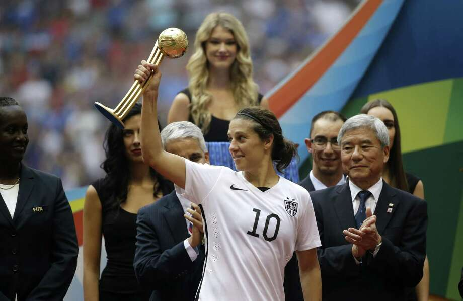 At 26, Carli Lloyd became the oldest American woman to score in a World Cup, above; In 2015 she was the MVP, left. Photo: Elaine Thompson / Associated Press 2015 / AP